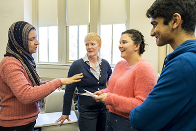 Mervat Youssef, Michele Regenold '89,  Sarah Cannon '19, and Ankit Pandey '20 discuss the class assignment