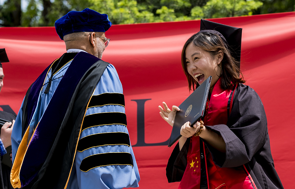 Xiaoxuan (Jessie) Yang '17 accepts her diploma from President Raynard S. Kington.