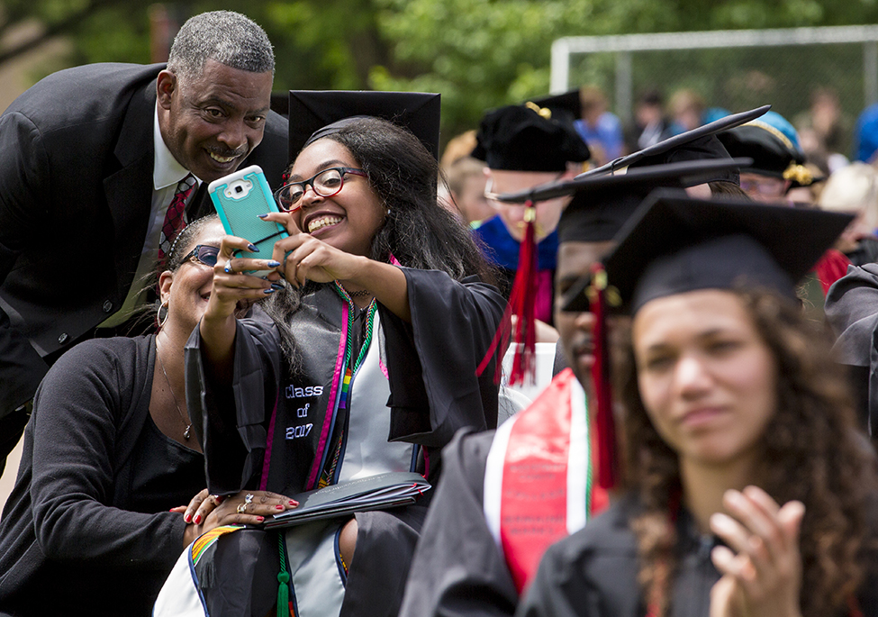 Gabrielle Matthews '17 takes  a selfie with her family.