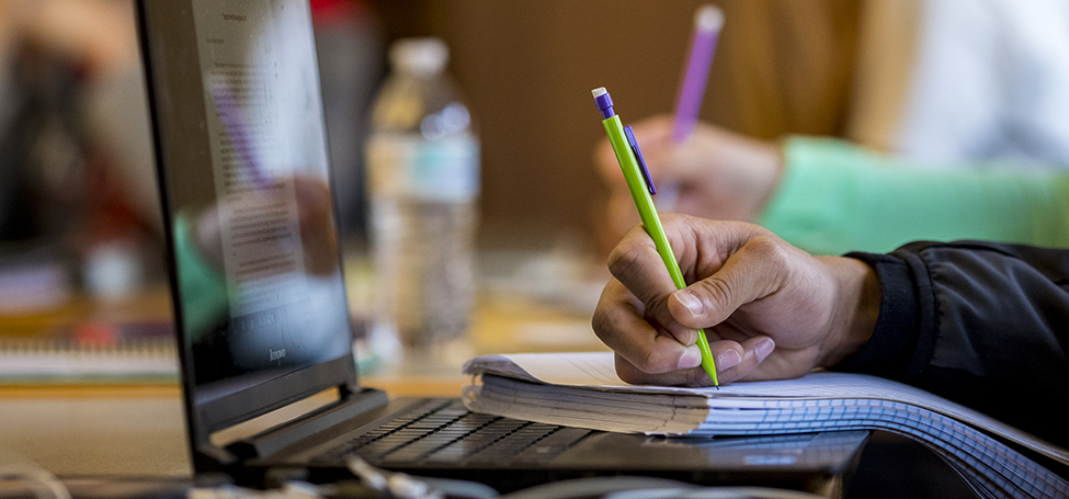 Student takes notes in notebook