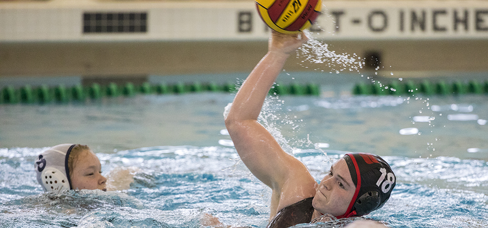 Grinnell water polo player with ball