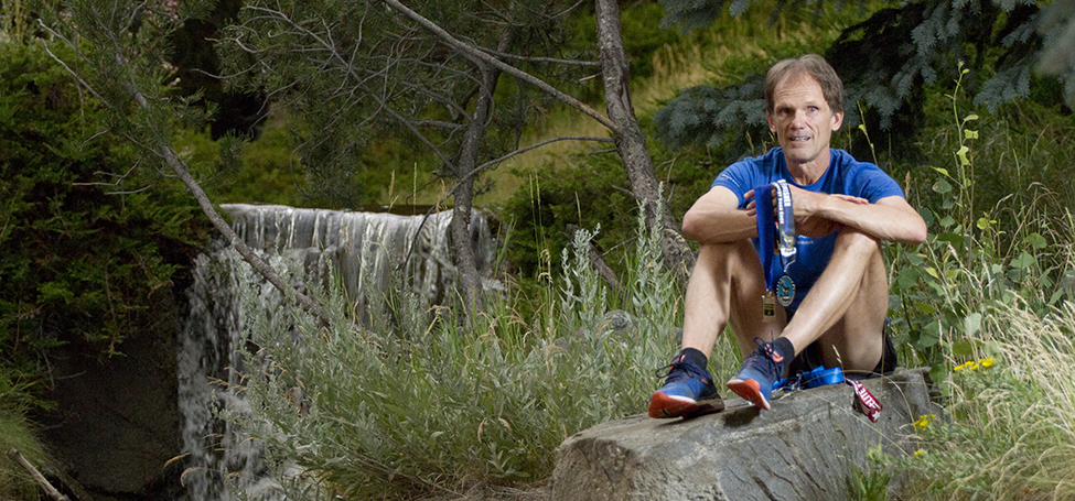 Roger Sayre '81 holds his race medals