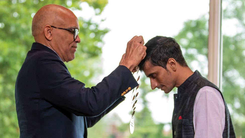 Raynard S. Kington bestowing the medal on the 2019 winner Shafiq R. Khan