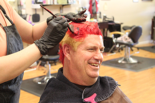 Andy Hamilton getting his hair dyed red