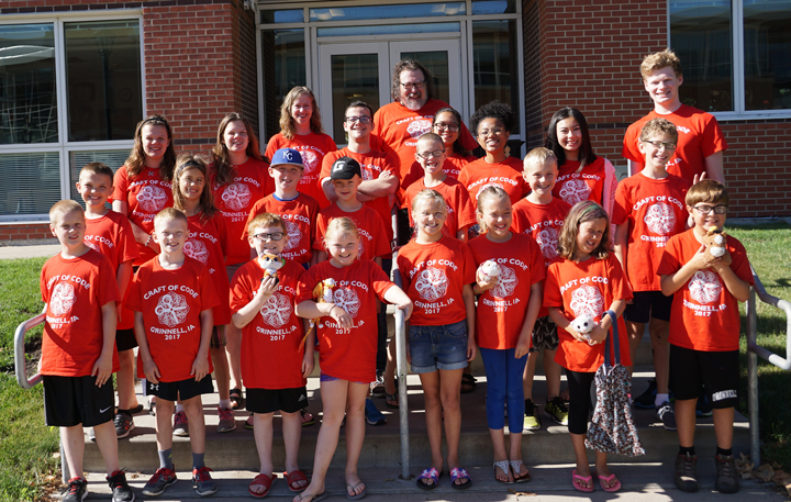 2017 Craft of Code camp attendees and instructors in matching orange tshirts