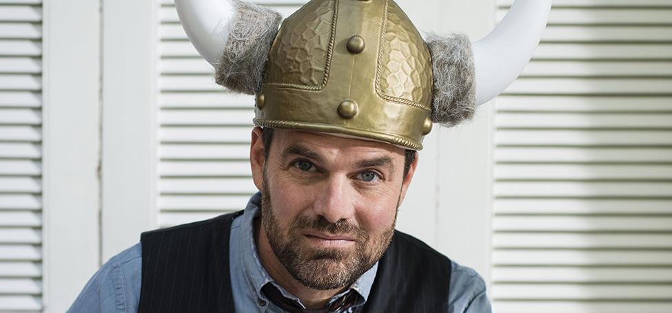 Grant Faulkner '87 writing with helmet on
