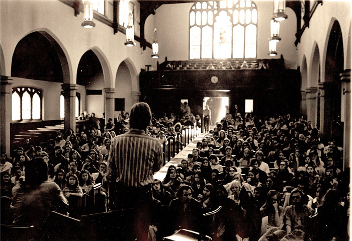 A 1972 peace rally in Herrick Chapel featuring Richard H. Stein '72 speaking to the attendees