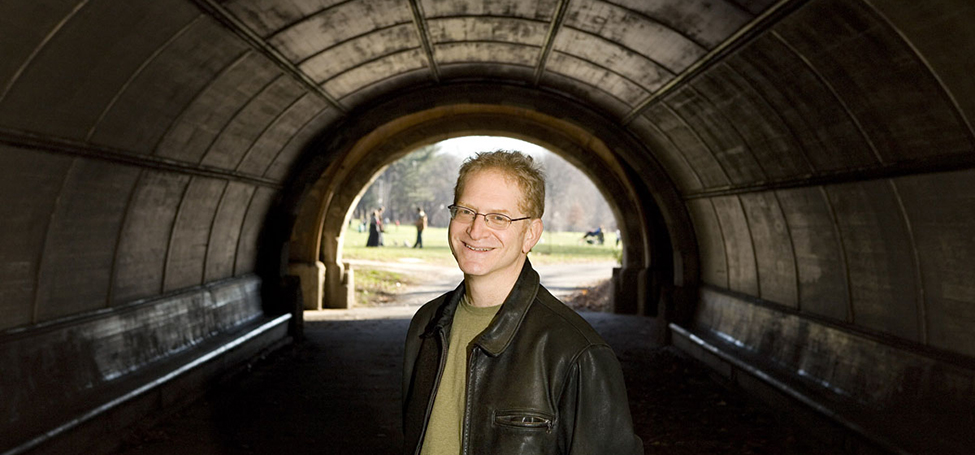 Tom Rayfiel standing in tunnel