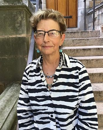 Mary Miller sits on a stoop