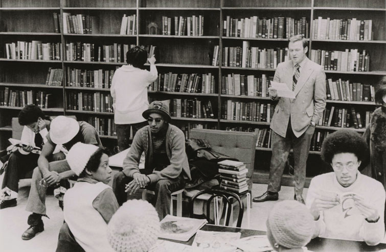 Wally Walker in library with group of black students