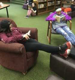 Students reading new books in the library