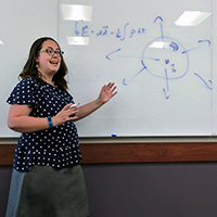 Eleanor Raulerson Sayre '02 presenting at white board