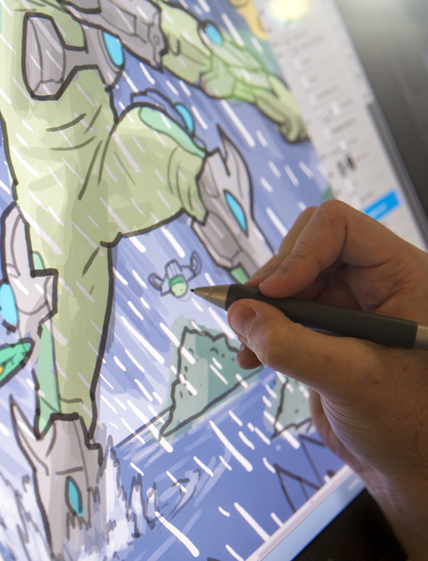 close up of hand drawing digital comic on screen