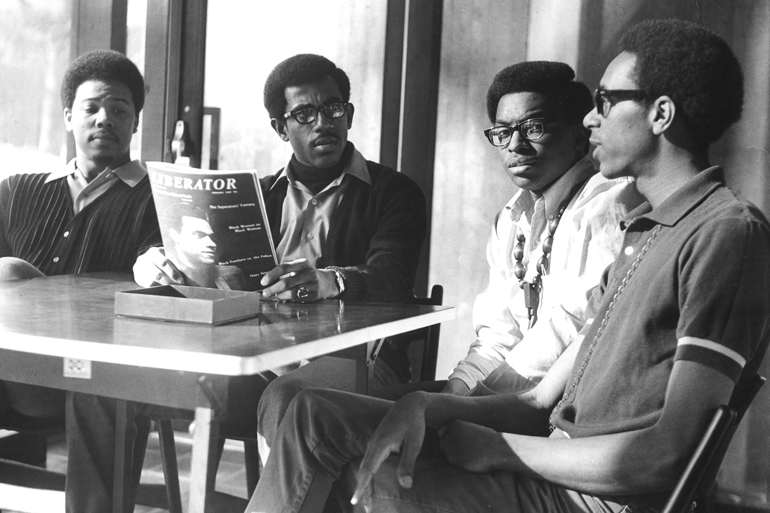 Four officers of the Concerned Black Students gather in the Forum in 1970