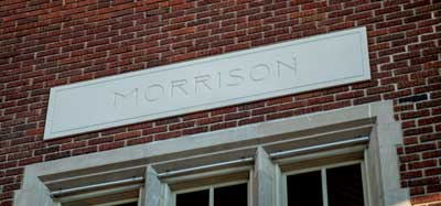 Morrison etched on stone plaque embedded in brickwork above large window