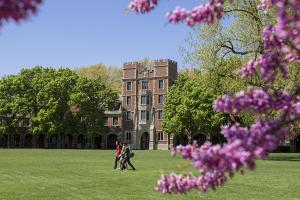 Students walking on MAC field in the spring