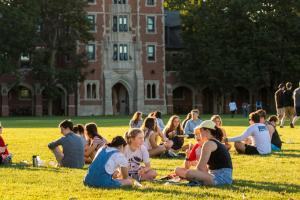 Students enjoy a bright day on Mac field
