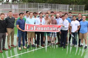 Group during tennis court naming