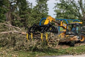 Large machinery in use to gather and move brush piles