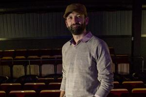 Andrew Sherbourne '01 shown in the theater at Film Scene in Iowa City