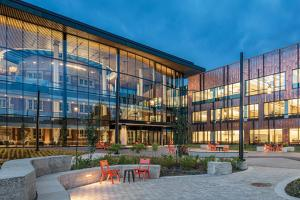 Humanities and Social Sciences Center and courtyard lit up at dusk