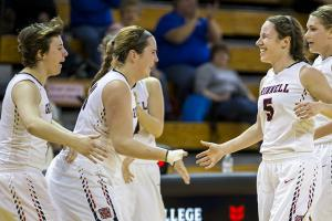 Alissa Hirsh and Anne Boldt celebrate with teammates as they come off the court.