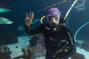 Amanda Hodo in water with fish