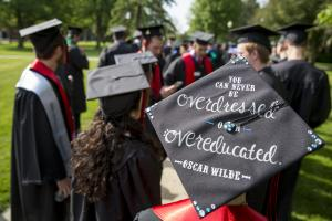 Mortar board reading 'You can never be overdressed or over educated. — Oscar Wilde'