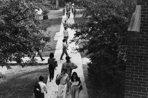 students walking on sidewalk on campus