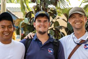 Mansir Petrie '99, right, pictured with Peace Corps colleagues in Panama in February 2020.