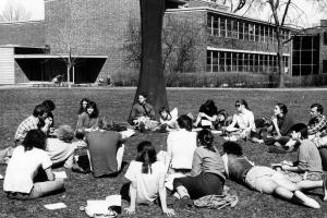 Students lounge in a ring near Zirkle's sculpture on central campus