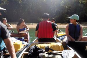 6 students paired in laden canoes