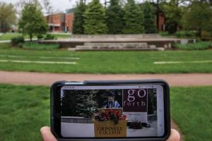 Cell phone shows President Kington's remarks in the prerecorded ceremony in front of the empty commencement stage