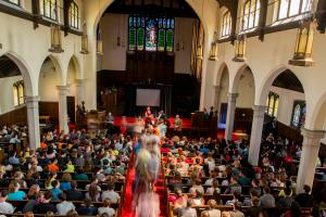 view of Herrick Chapel full of people from the balcony