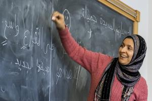 Mervat Youssef teaches in front of the classroom