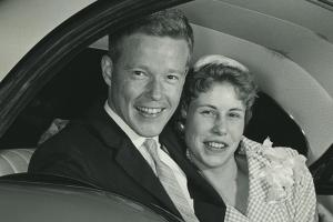George and Sue in the backseat of a car after their wedding