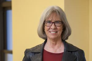 Jeanne Pinder '75 standing outside her office