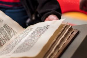 Old book open for student perusal