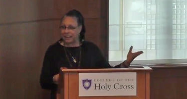 Katya Gibel Mevorach speaking to Holy Cross audience