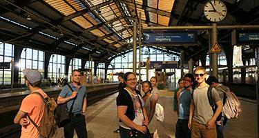 Group of students waits for a train in Europe