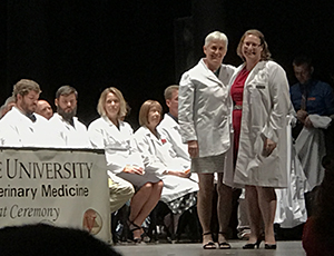 White coat ceremony with Miranda Thomas '17 and Sara Mathews '82