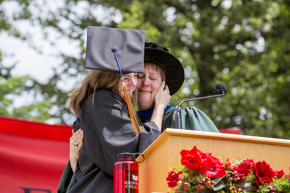 Lizzie Eason '17 hugs Karen Shuman, professor of mathematics and statistics