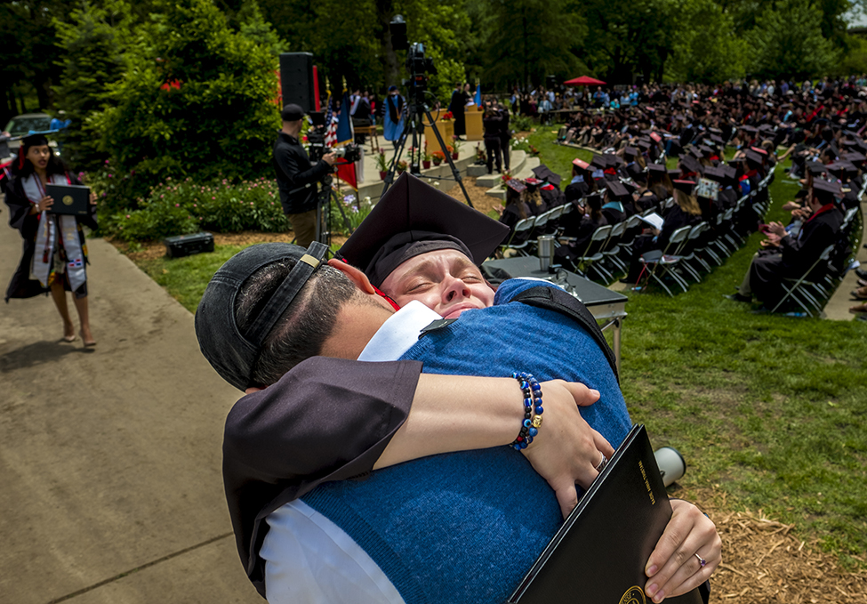 Sadie Tristam '17 embraces her dad after coming off the commencement stage.