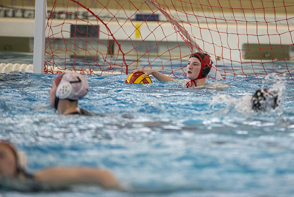 Water polo goal keeper has ball