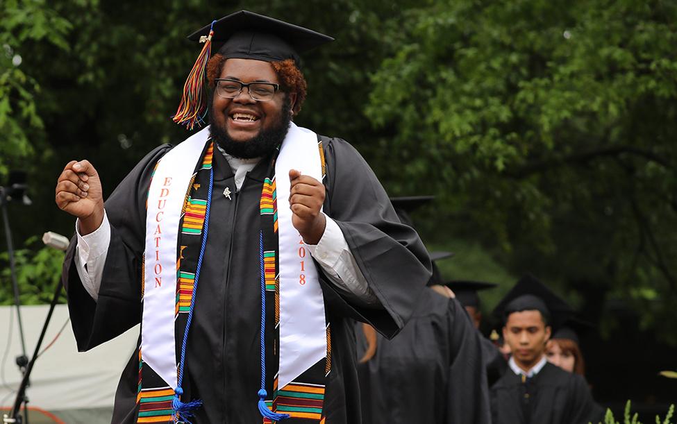 Grad celebrates across the stage