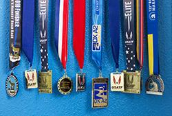 Roger Sayre '81 race medals