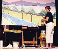 Ginny Olson Richardson at work on canvas