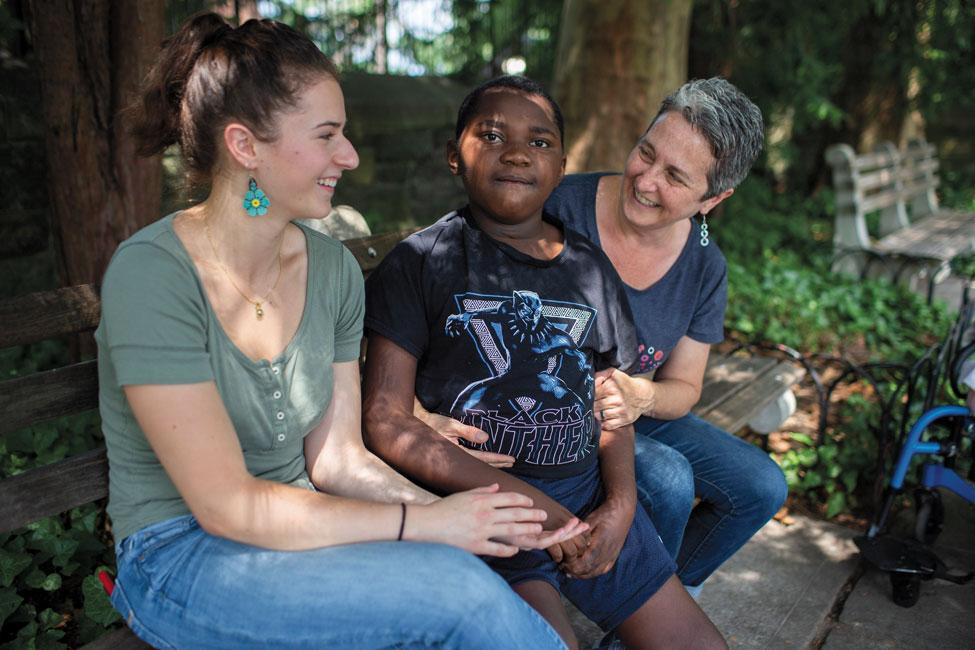 Sarah Weltz, Sandra Joy Stein, and Stein's son sitting on a park bench