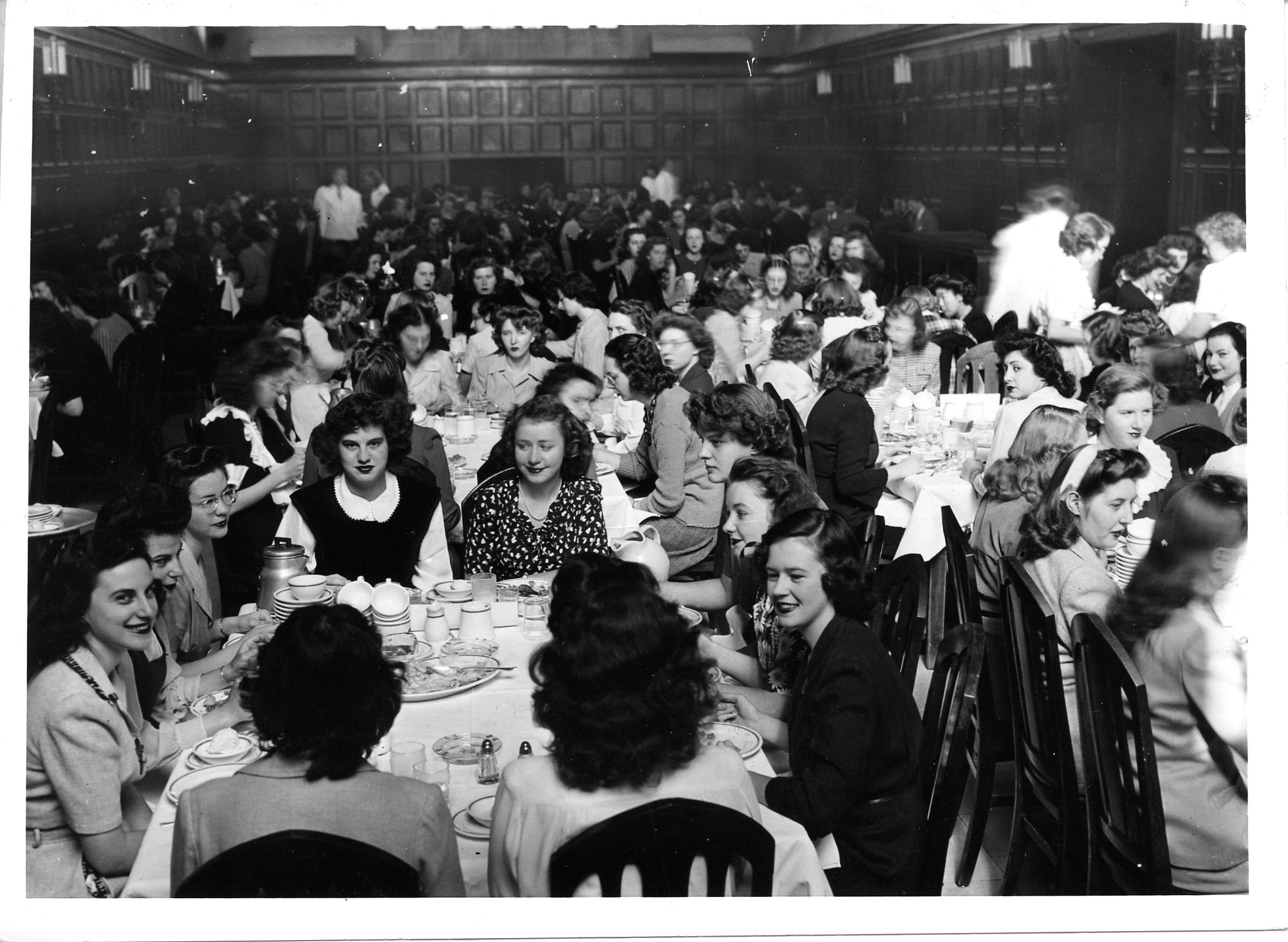 Black and white photo of women dining in Quad dining hall,1944