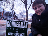 Erin Gonnerman poses by one of her campaign signs